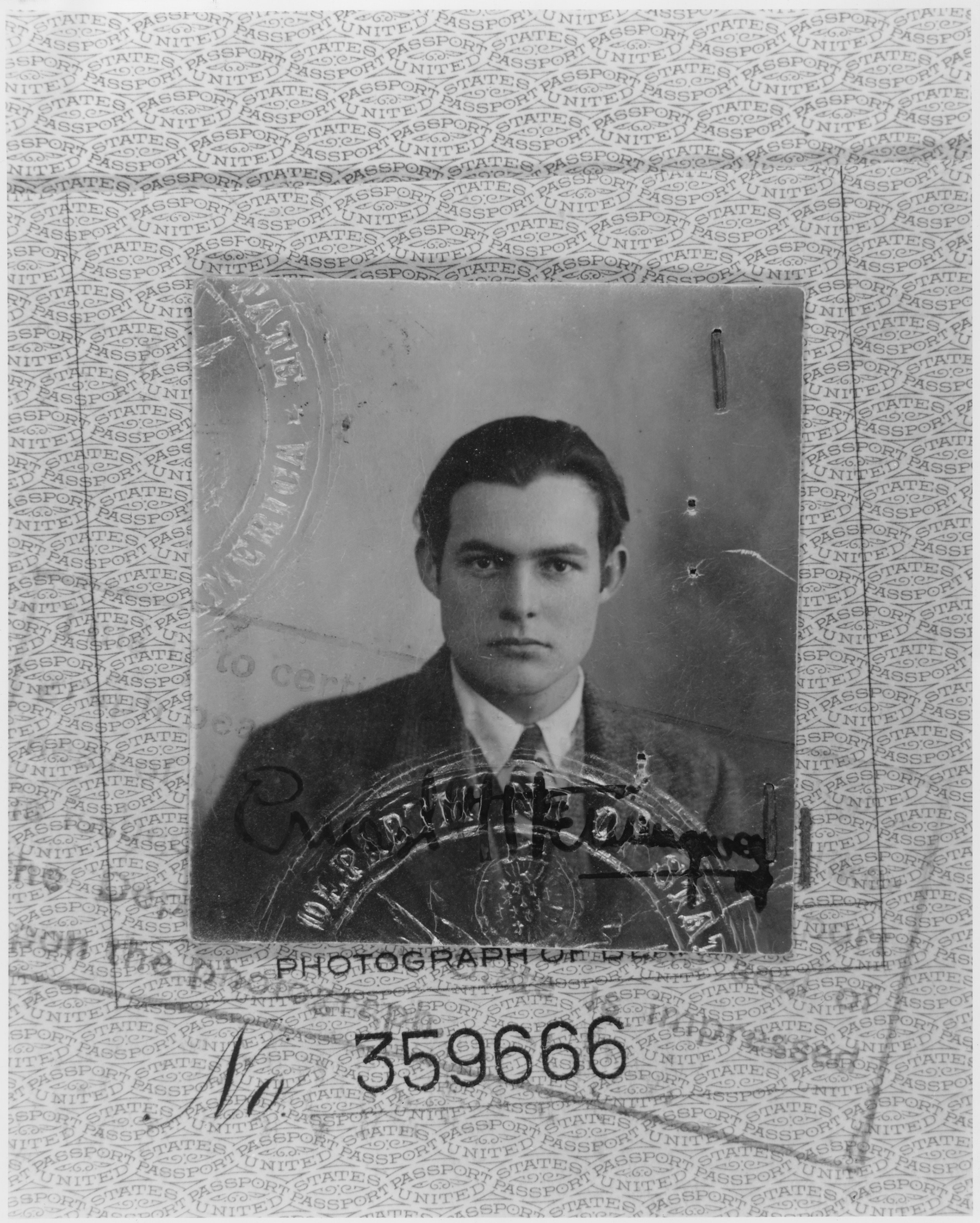Ernest_Hemingway_passport_photo_40-1548M