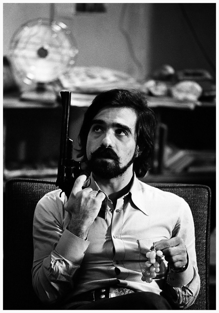 martin-scorsese-with-one-of-the-guns-used-by-robert-de-niro-on-the-set-of-taxi-driver-photo-steve-shapiro-1976